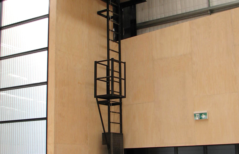 powder-coated-ladder-with-a-vertical-fall-arrest-device-attached
