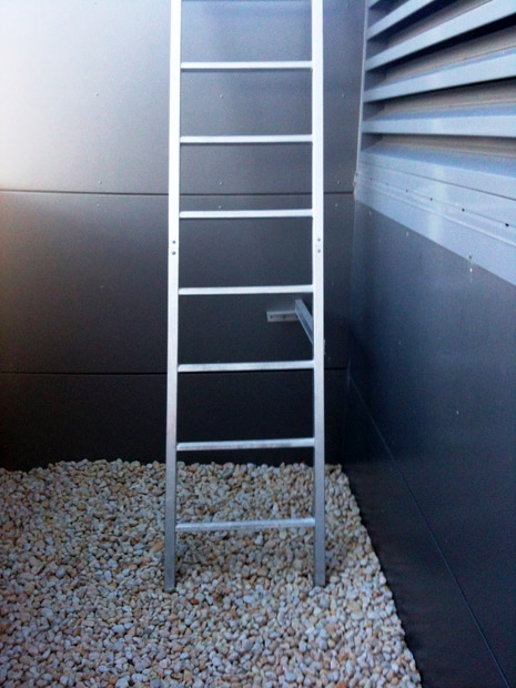 ladder-base-fixed-into-gravel